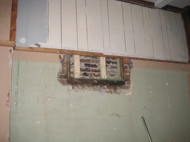 Plaster Covering Brick.JPG