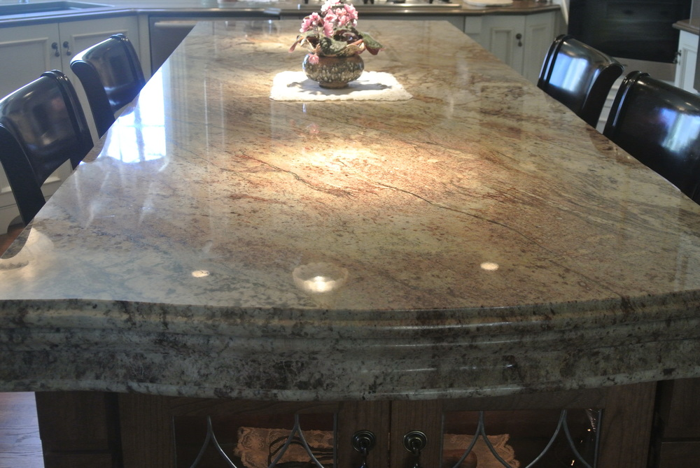 TYPHOON BORDEAUX GRANITE  Custom edge and apron work done by Armando at 5280 Stone