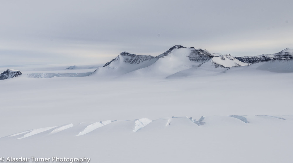Crevasses in the Trans-Antarctic Mountains, Antarctica.   Shot from a Bell 212.