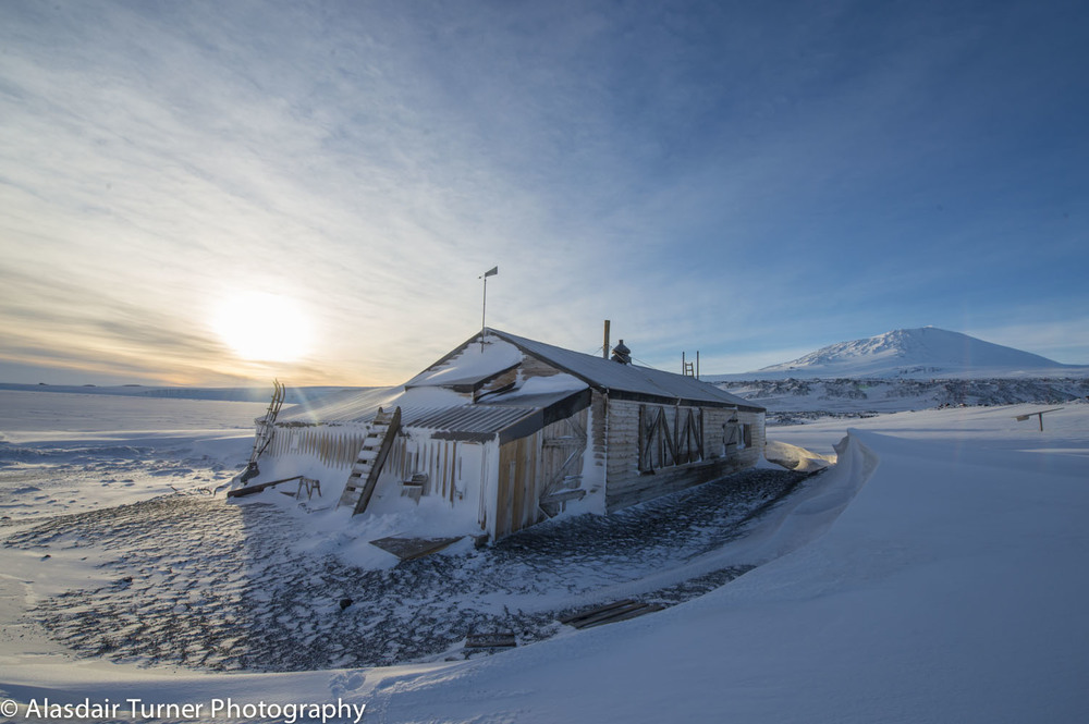 Sunset over Robert Falcon Scott's Terra Nova hut at Cape Evans, Antarctica.