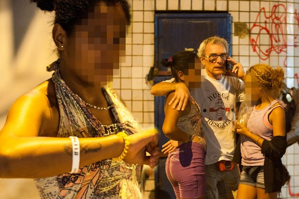 Brazil's streets are filled with 'thousands' of desperate kids. Two pictured here with a missionary charity worker