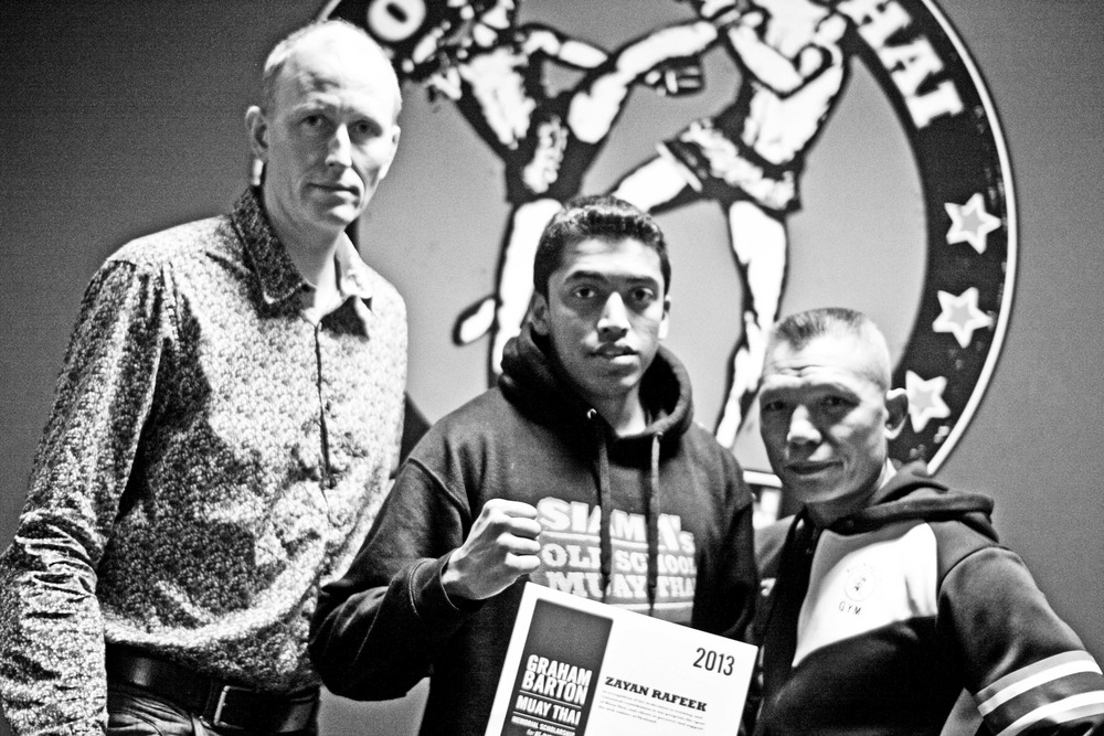 Kru James Hines owner of Siam No.1 Old School Muay Thai & Ajahn Suchart a world leading Muay Thai expert & owner of Siam No.1 House of Muay Thai, celebrating the first Graham Barton Scholarship received by Zayan Rafeek in 2013
