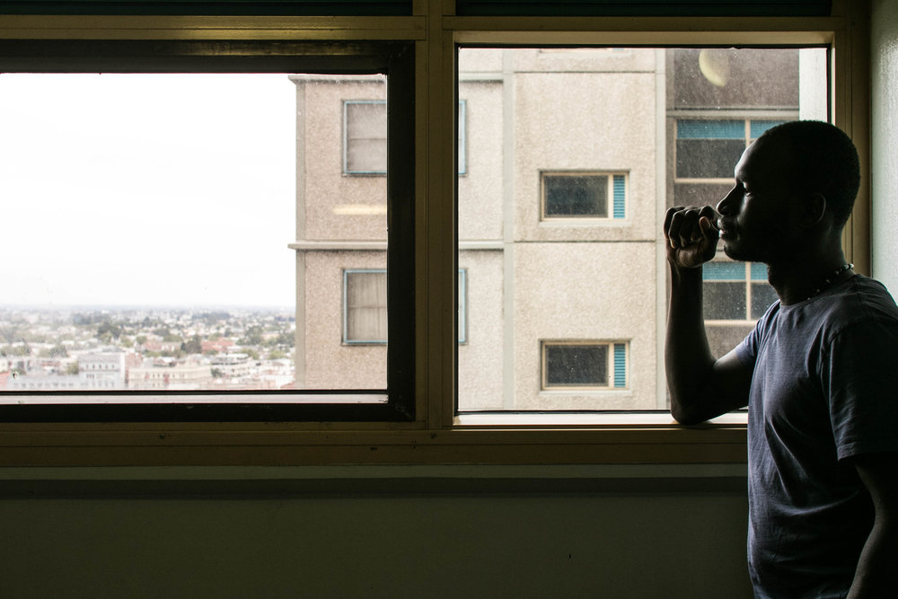 Izzy looks out of the project housing window © Sid Naidu