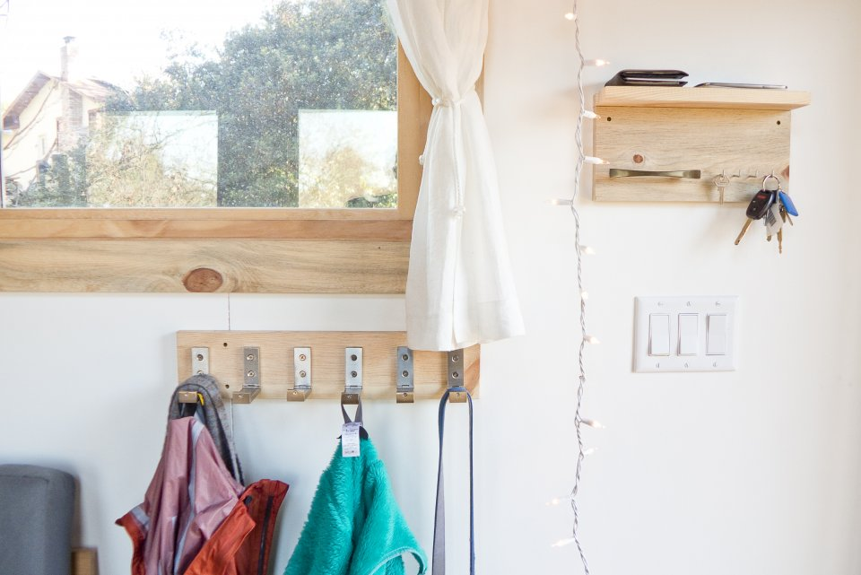 the-home-is-uncluttered-with-plenty-of-innovative-storage-spaces-there-are-shelves-fold-away-cupboards-and-hooks-to-hang-things.jpg
