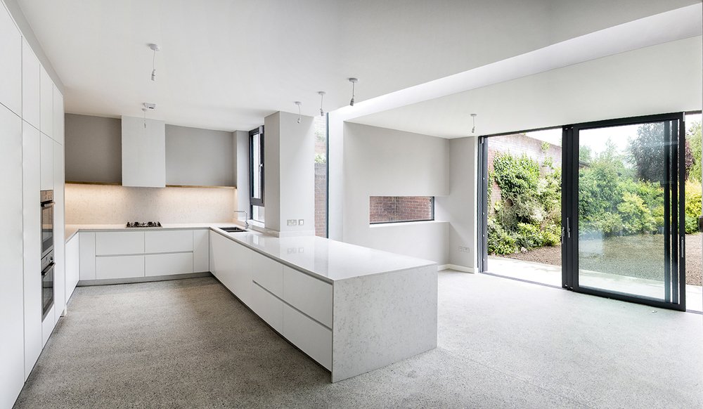 Kitchen and extension with triple sliding doors to garden