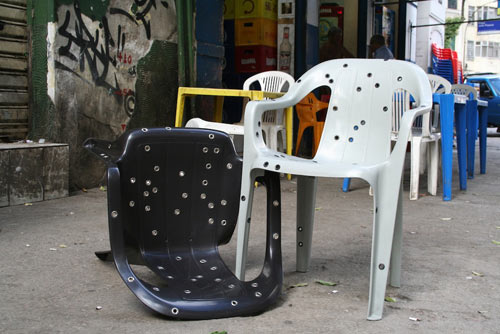 Stray Bullet Chairs on the street