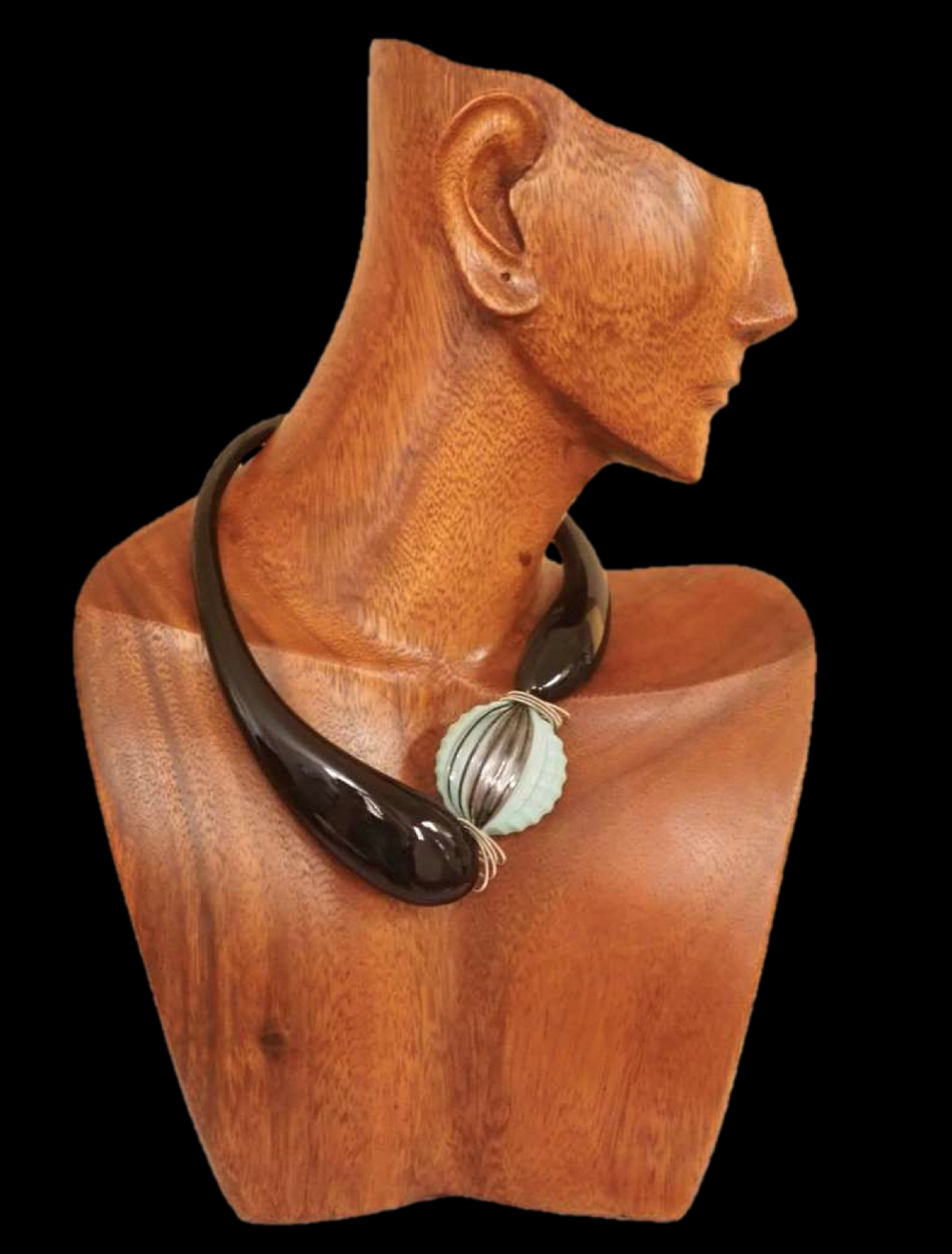 Joan Greiff is originally from Canada and now lives in Santa Monica. She has studied art and jewelry design and her neck-art pieces are sold in boutiques in California.