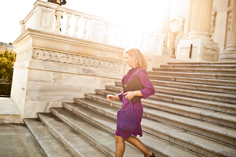 Congresswoman Debbie Wasserman Schultz walks down the steps of the US Capitol Building.