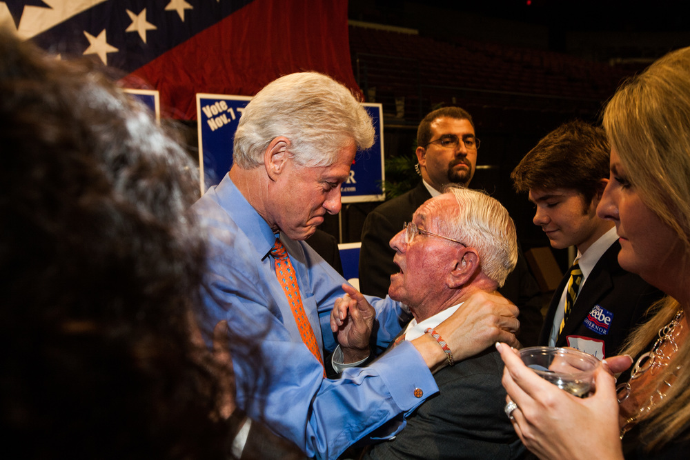 Former President Bill Clinton speaks to a supporter after a rally in Little Rock, Arkansas.