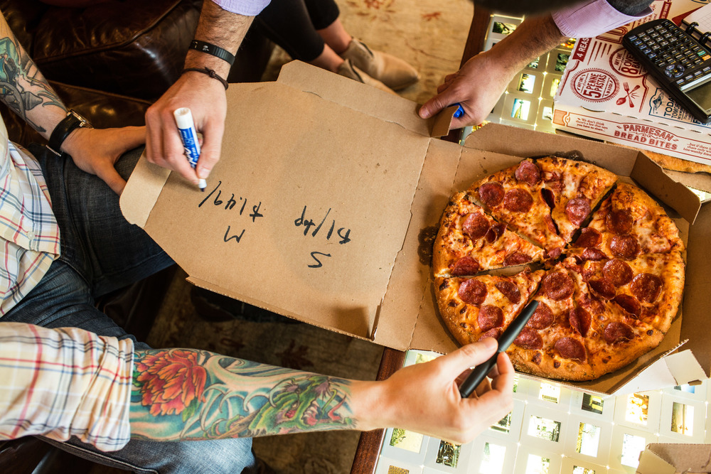 The Mathalicious team talks about a new lesson involving Domino's Pizza at the company headquarters in Charlottesville, Virginia.