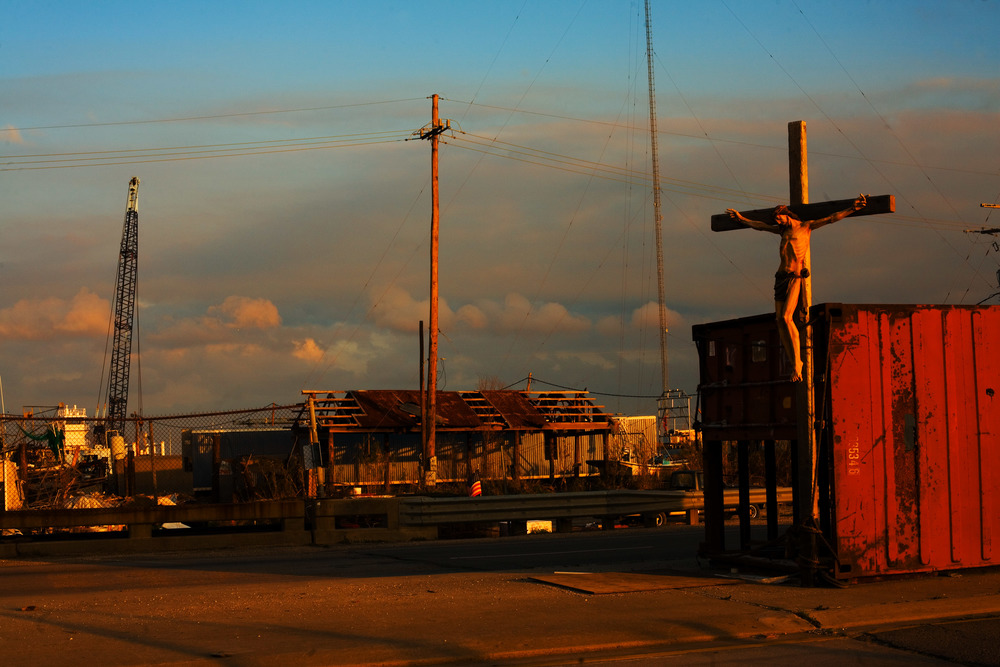 A crucifix stands in the middle of a highway, post-Hurricane Katrina in New Orleans, LA