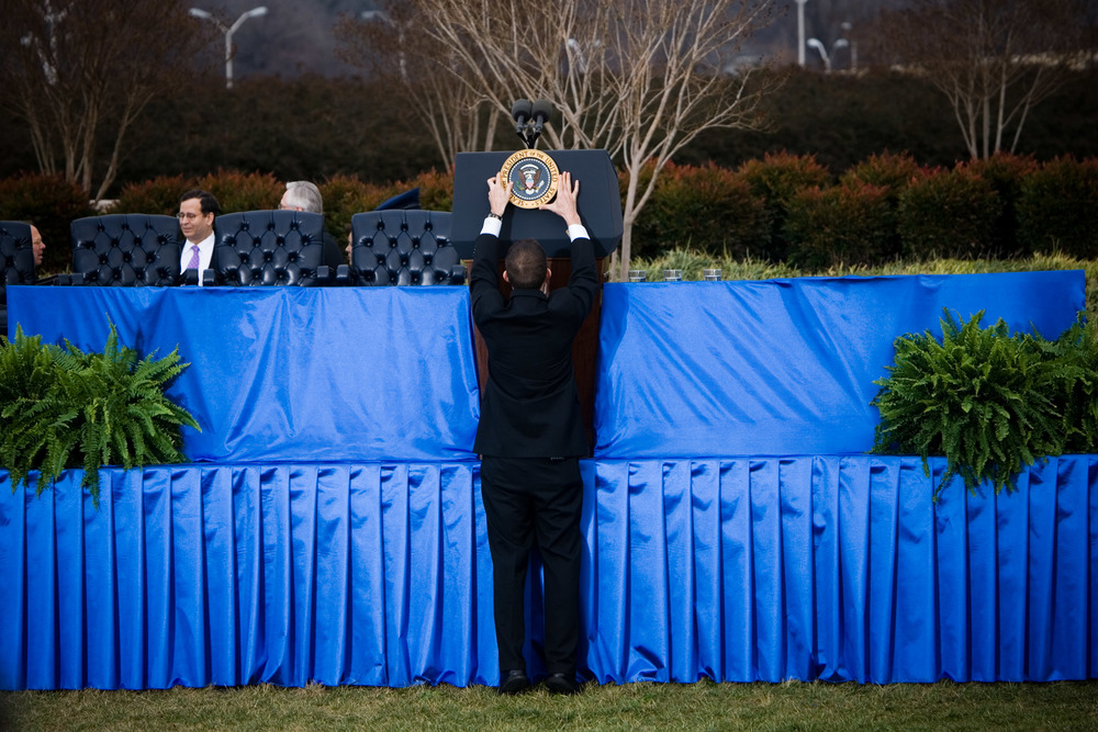 The Presidential seal is placed on the podium prior to an event at the Pentagon