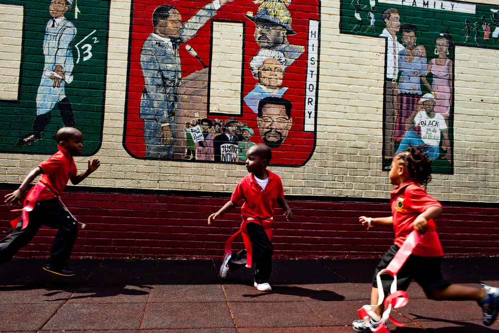 Children play during recess at Roots Public Charter School in Washington, DC.