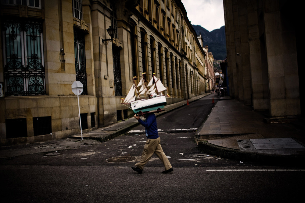A man carries a model sailboat in Bogota, Colombia.