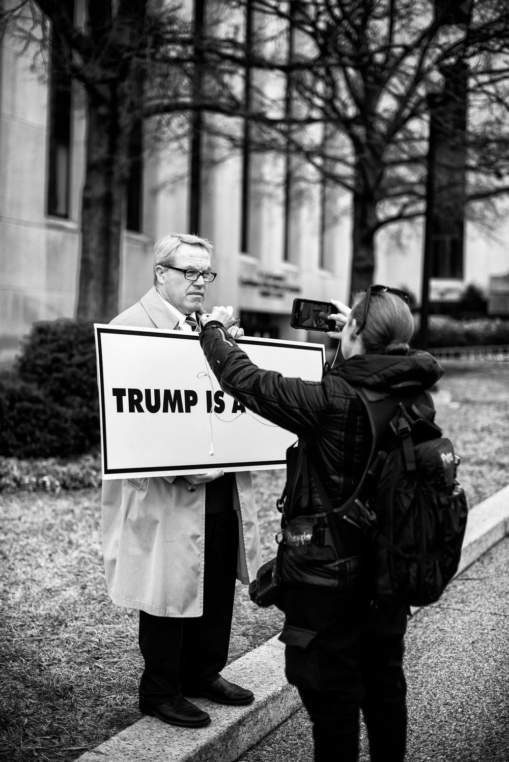 A protester is interviewed prior to the Presidential Inauguration in Washington, DC on January 20, 2017.