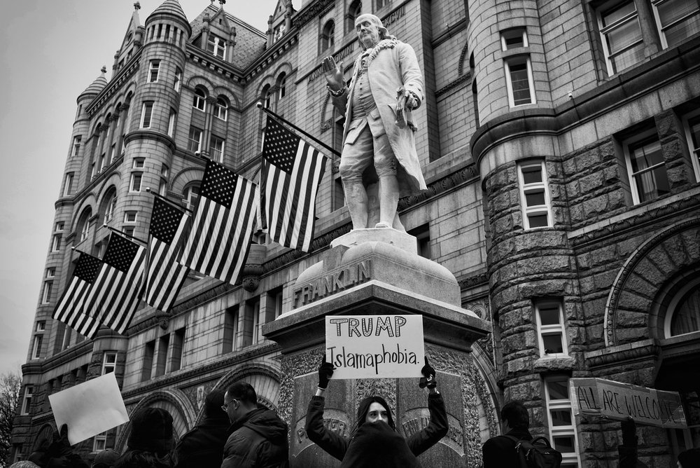 Protesters gather in front of the Trump hotel after President Trump's executive order banning people from seven countries from entering the United States, on January 29, 2017.
