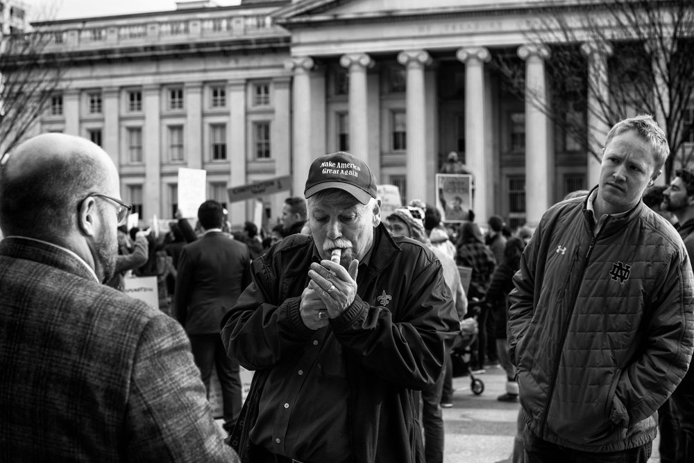 A Trump supporter speaks with protesters near the White House after President Trump's executive order banning people from seven countries from entering the United States, on January 29, 2017.