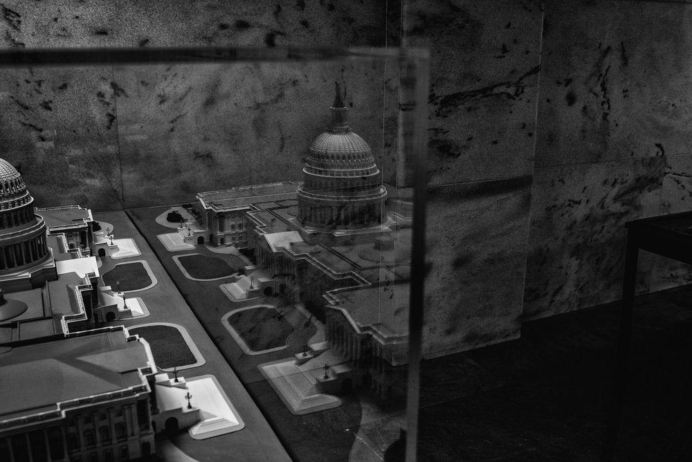 A model of the US Capitol is reflected in its protective case at the Rayburn House Building on February 1, 2017.