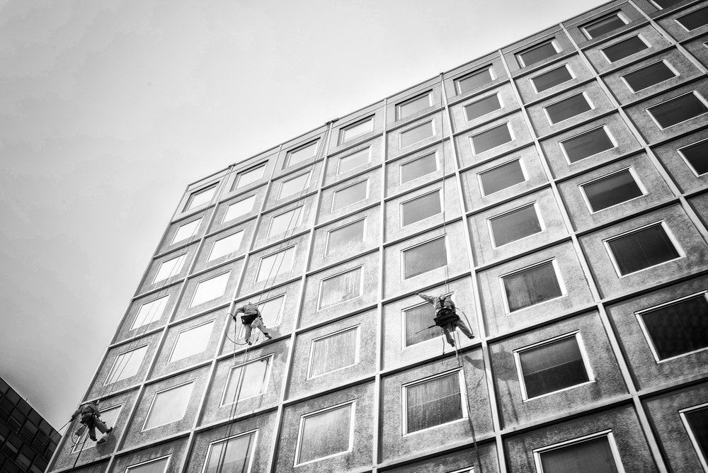 Window washers along 17th Street NW on March 25, 2017.