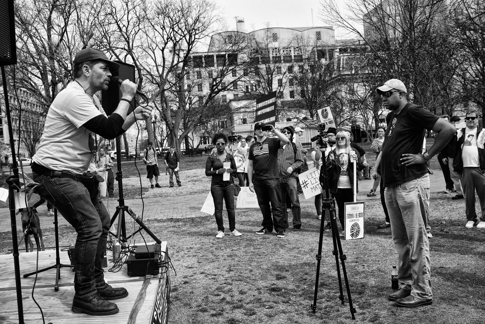 A pro-Pizzagate rally in Lafayette Square in front of the White House on March 25, 2017. Speakers demand an investigation into unfounded claims that a child sex trafficking ring is somehow connected to Comet Pizza, a local pizzeria in Washington, DC.