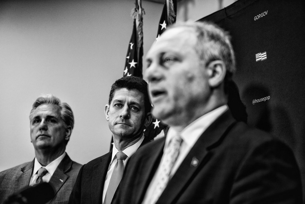 House Speaker Paul Ryan and House Majority Leader Kevin McCarthy listen to House Majority Whip Steve Scalise speak to the media during a briefing after attending a closed House Republican conference on March 28, 2017