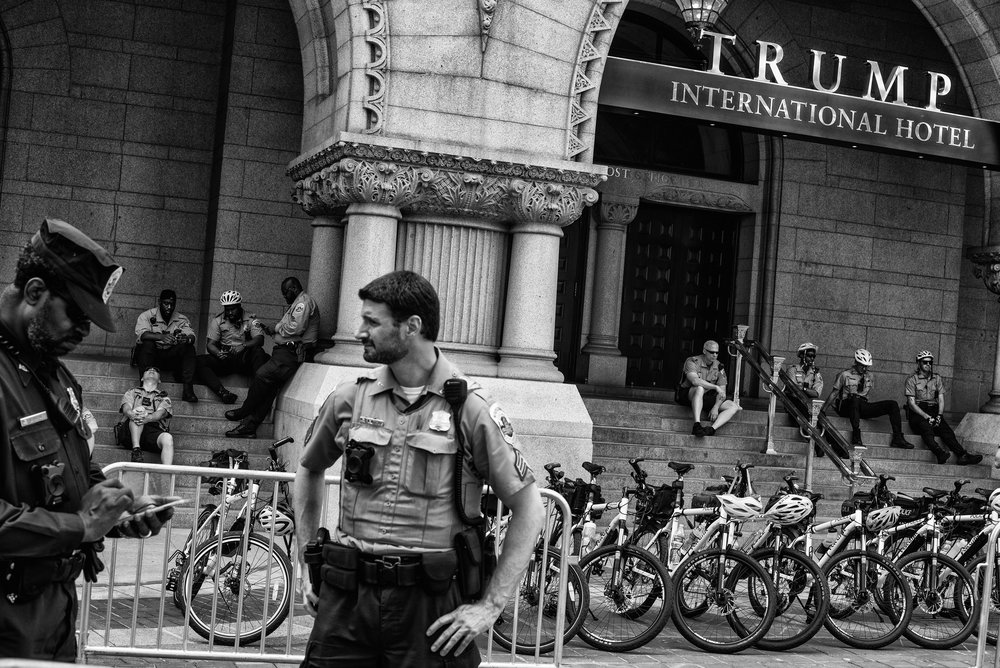Day 100 : Police are stationed in front of the Trump International Hotel during the People's Climate Movement to protest President Donald Trump's environmental policies, on April 29, 2017.
