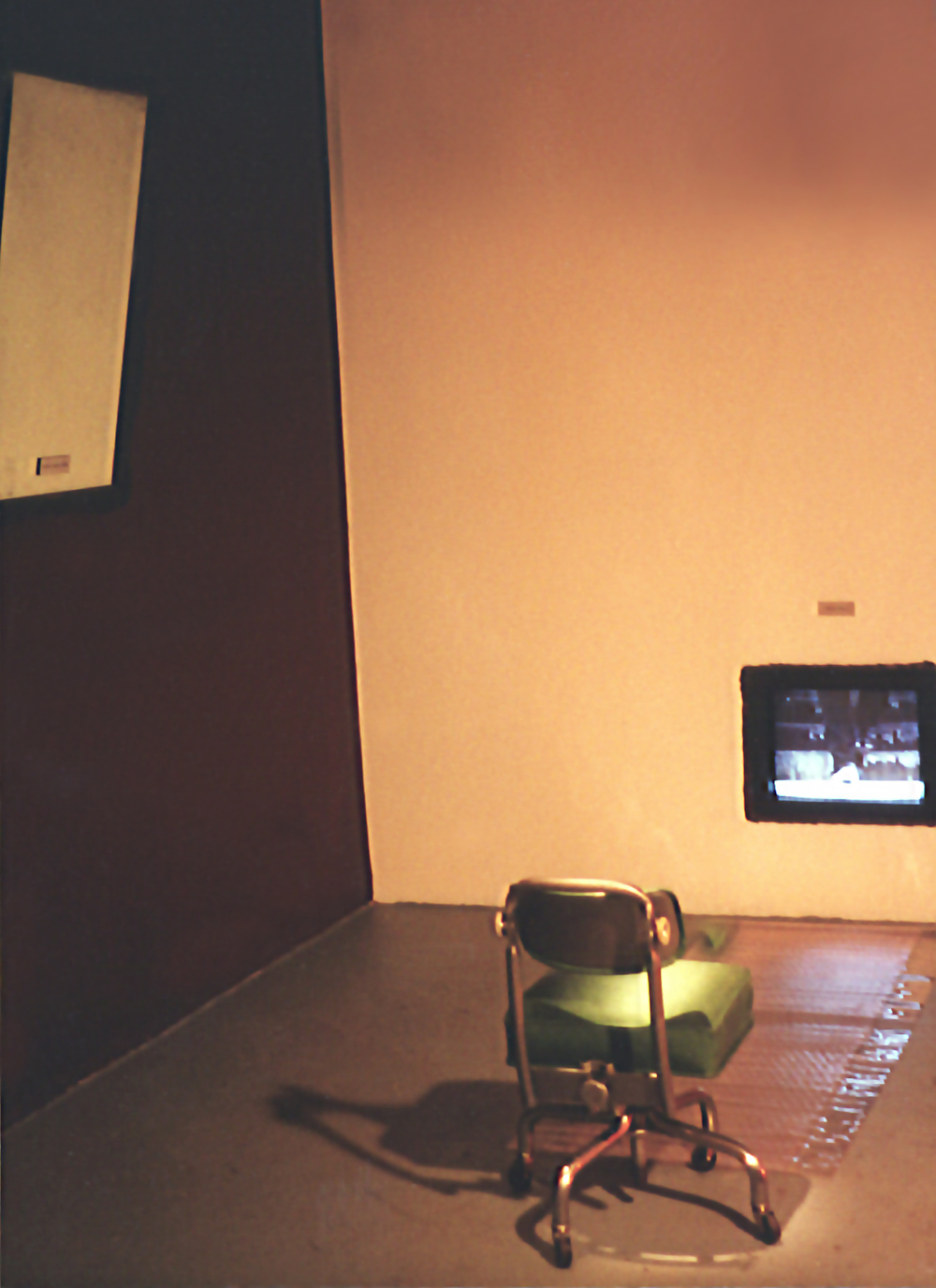 View of video installation, mirror, chair
