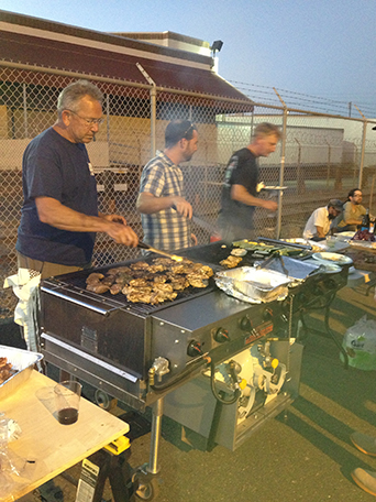 Gardeners, Terry B, Will B and Jeff H, hard at work making BBQ for the last night bash!