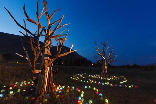 "Veteran Exquisite Gardener Sam Dantone's amazing ""pallet trees"" made from recycled wooden pallets..surrounded by solar powered japanese- style lanterns."