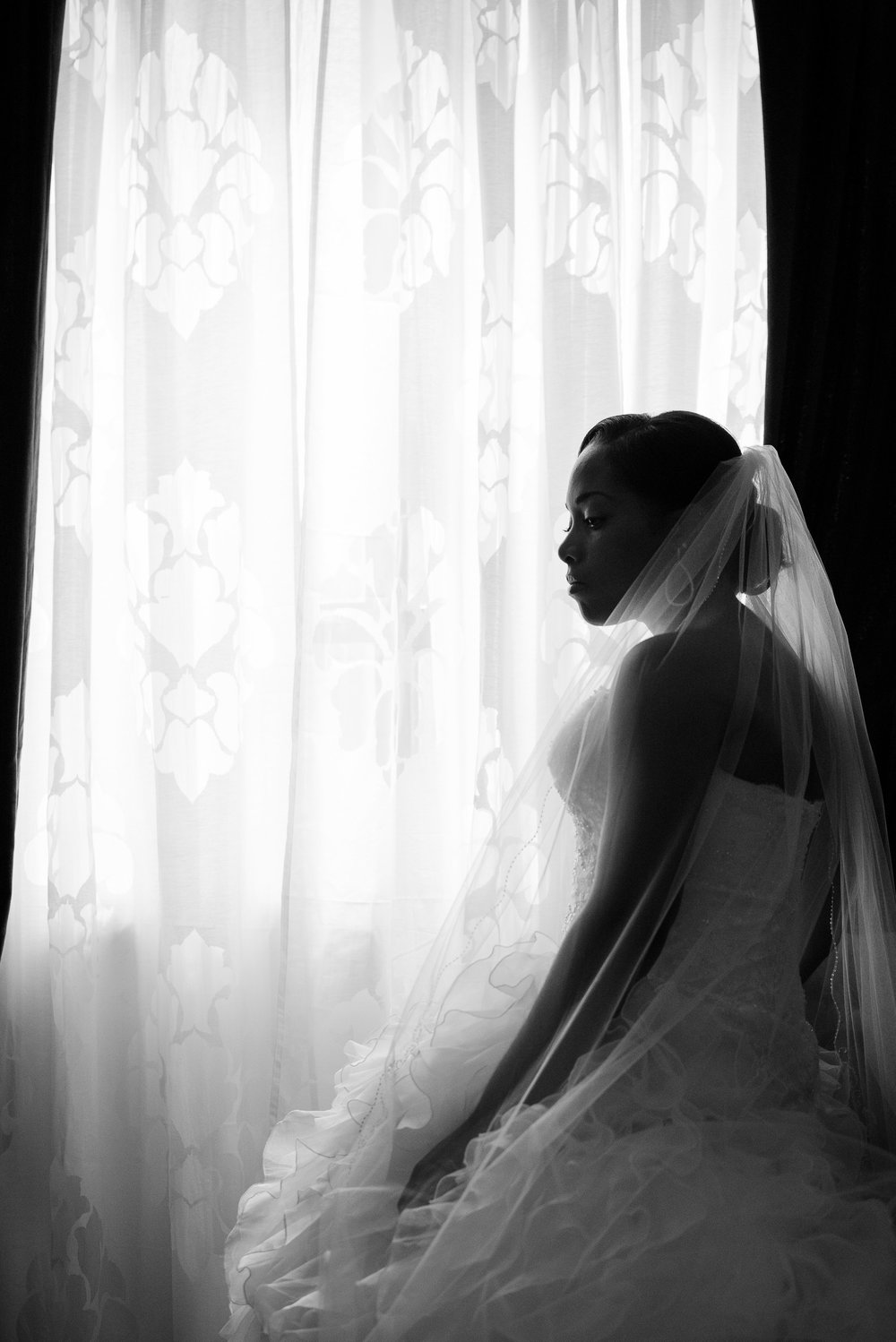 A beautiful bride relaxes before her walk down the aisle.