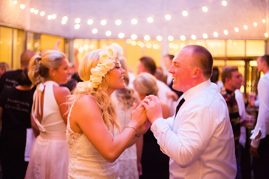 Wedding dance, reception party, courtyard garden party, twinkle lights, bride and groom dancing, bride flower crown, Events on 6th, Photo by RP Imagery