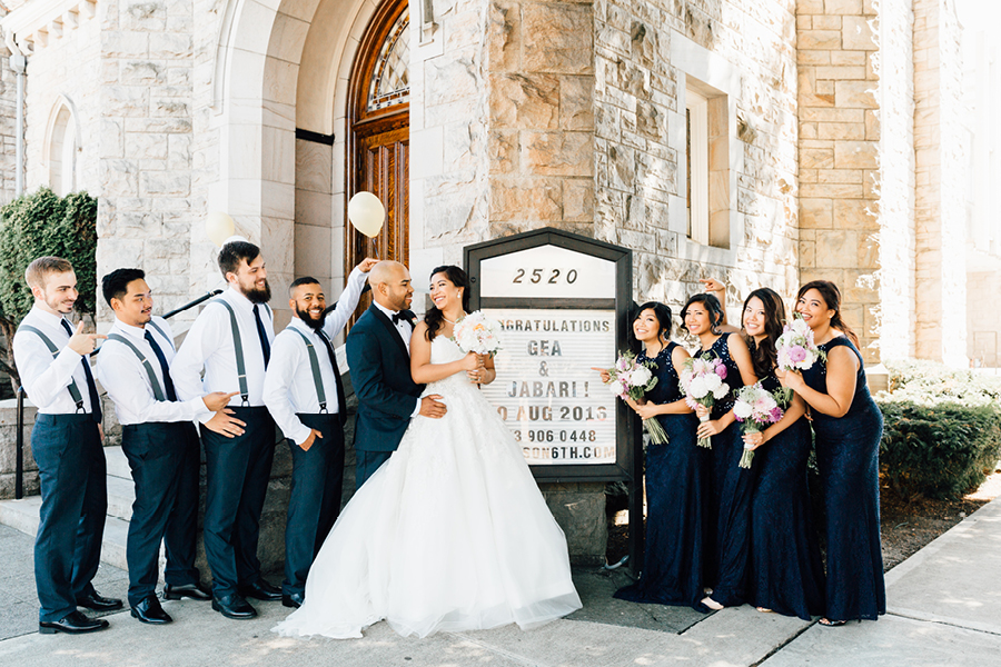 Wedding party portrait outside, marquee sign, bride and groom portrait, stone church wedding venue, Events on 6th, Photo by Something Minted Photography