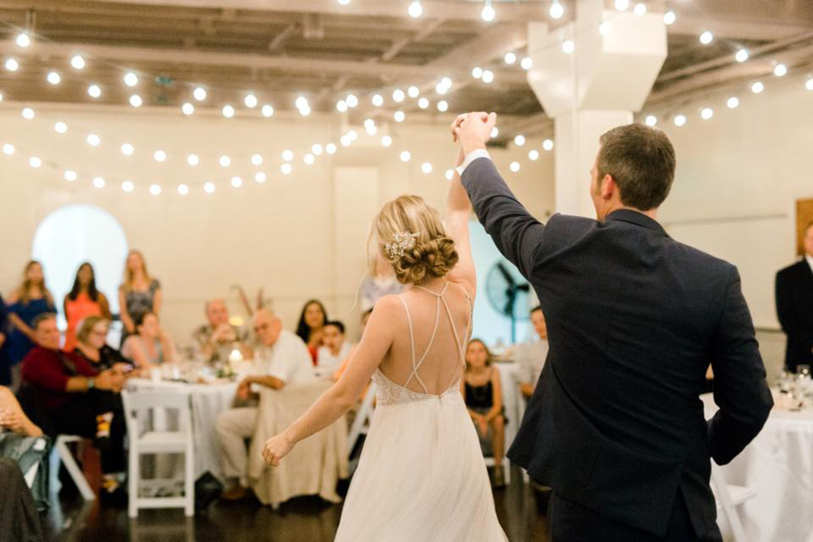Bride and groom first dance, wedding reception, party, twinkle lights, Events on 6th, Photo by Ink and Grain Photography