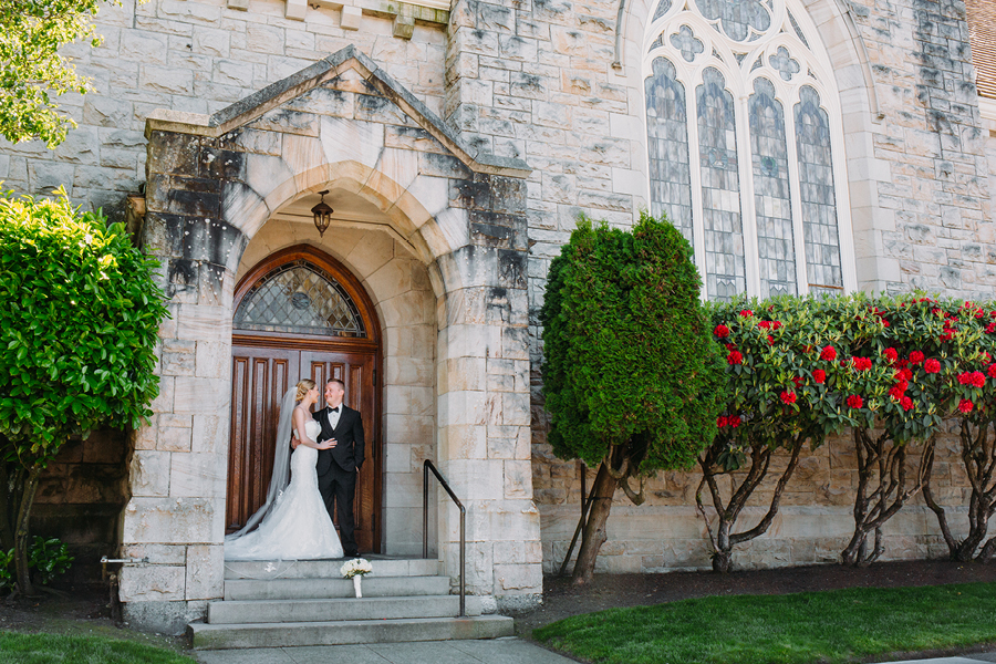 Bride and Groom on church steps, wedding portrait, stone church, Tacoma wedding venue, Events on 6th, Photo by Vio Regus