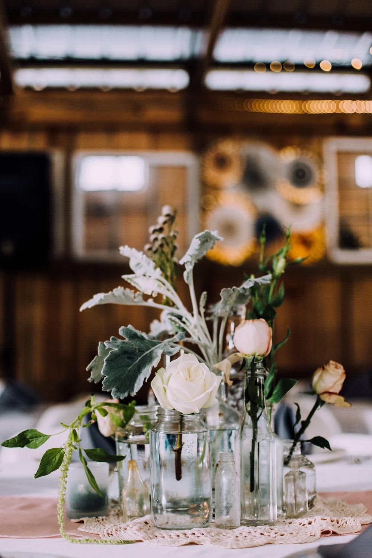 floral centerpieces vintage glass bottles