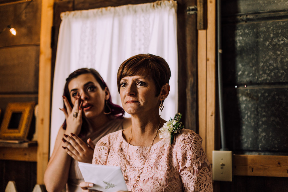 mother of the bride and sister of the bride tearing up at father daughter first look
