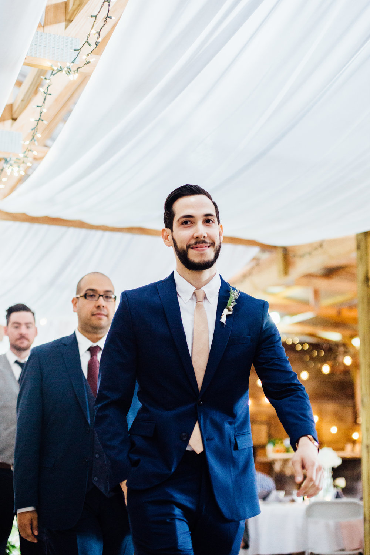 groom walks into ceremony