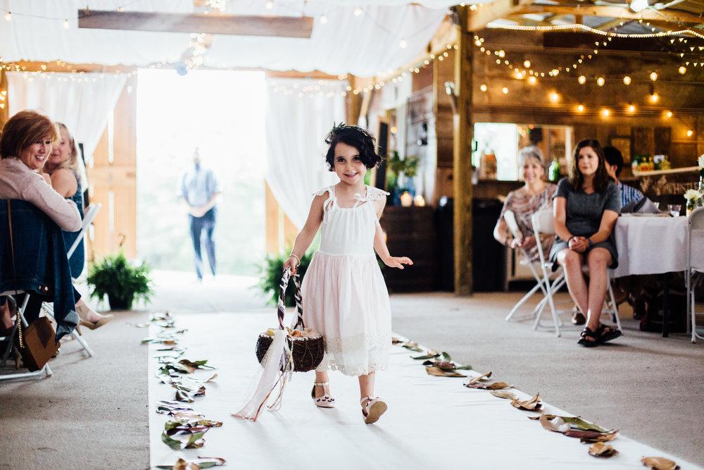 adorable flower girl barn wedding