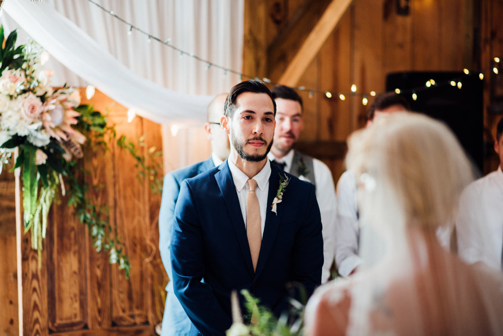 groom tears up seeing his lovely bride walk down the aisle