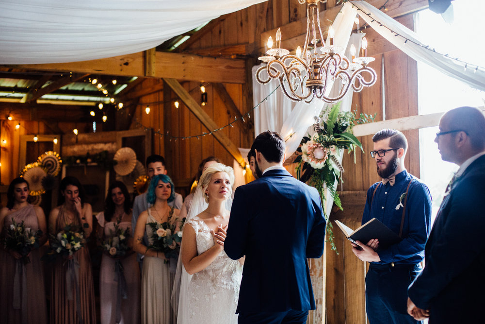 touching vows between bride and groom barn wedding