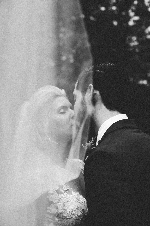 bride and groom kissing portraits veil