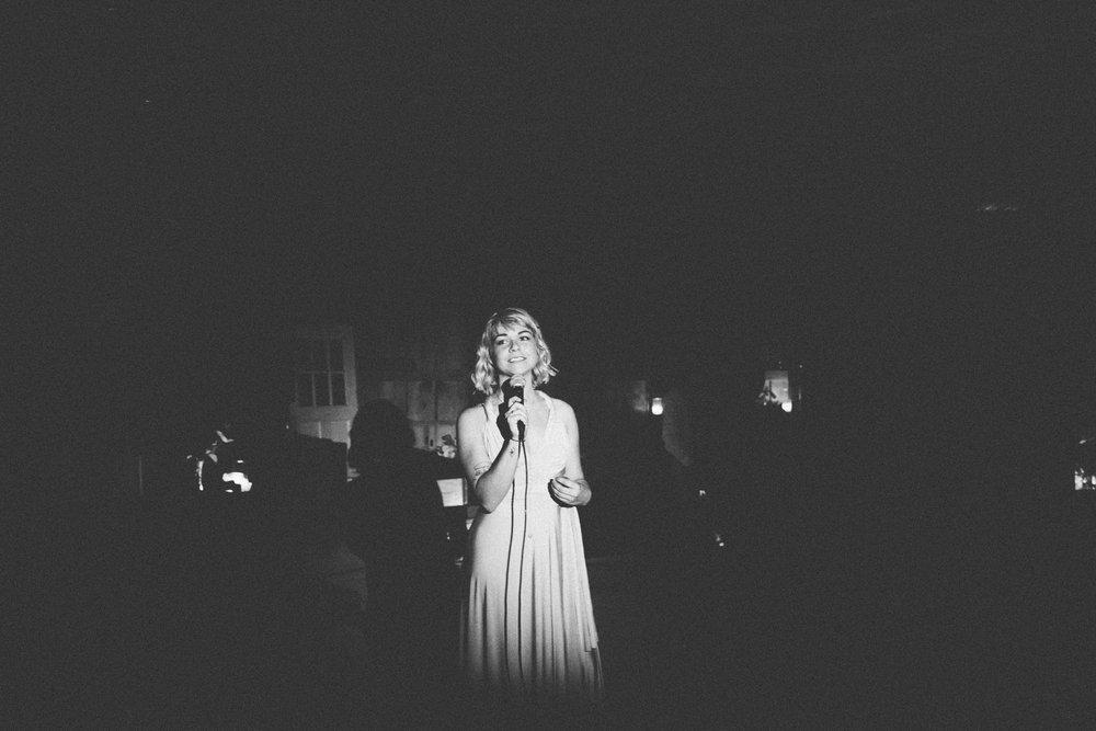 bridesmaid giving speech at reception