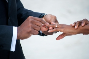 African American couple getting married and exchanging rings