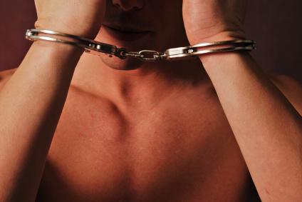 shirtless-man-handcuffs.jpg