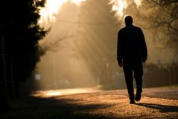 man-walking-alone-into-sunset.jpg