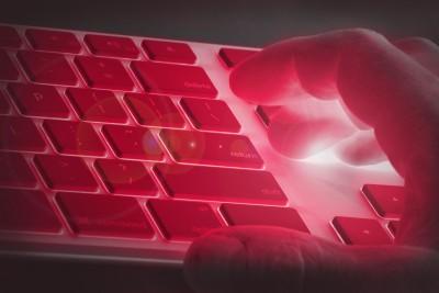 hand-on-keyboard-red-light-danger.jpg
