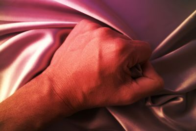 orgasm-hand-grabbing-sheet.jpg