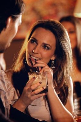 Attractive woman in a bar flirting with a man
