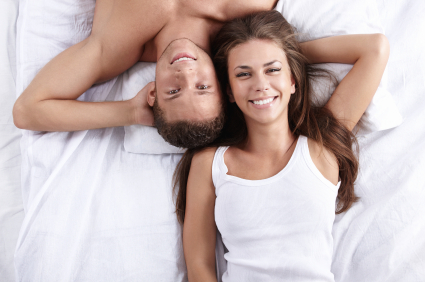 Friends with benefits in bed smiling