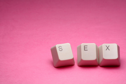 "Keys from a computer keyboard spelling out the word ""sex"" on a pink background"